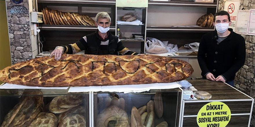 2 metre 45 santimlik pide yaparak 'Evde kal Türkiye' çağrısında bulundu