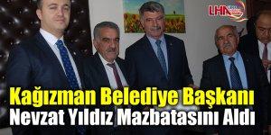 Kağızman Belediye Başkanı Nevzat Yıldız mazbatasını aldı