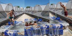 Antalya'da çocukların domates kasasında havuz keyfi