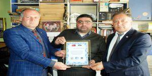 KKDGC Başkanı Daşdelen'e Türkiye-Azerbaycan Kardeşliğine Verdiği Önemden Dolayı Plaket