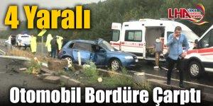 Otomobil Bordüre Çarptı: 4 Yaralı